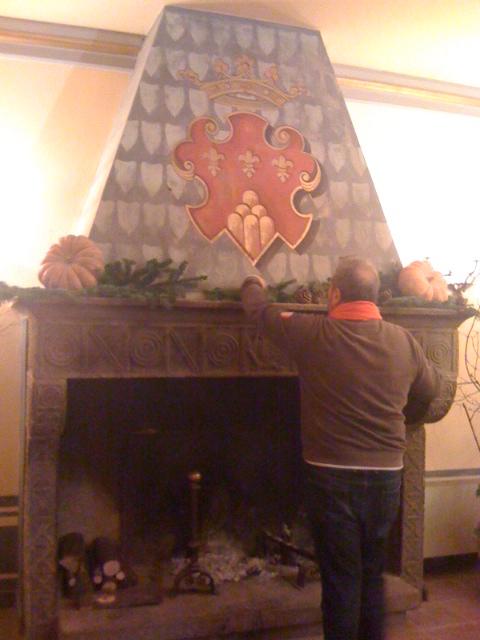 Our chef Aldo decorating the fireplace